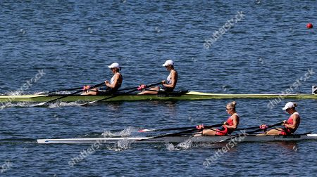 Magdalena Fularczyk-Kozlowska and Natalia Madaj, of Poland, right, and Victoria Thornley and Katherine Grainger, of Britain, compete in the women's rowing double sculls final during the 2016 Summer Olympics in Rio de Janeiro, Brazil
