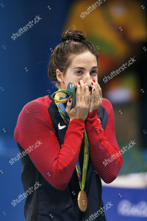 United States' Maya DiRado holds up her gold medal in the women's 200-meter backstroke medals ceremony during the swimming competitions at the 2016 Summer Olympics, Friday, Aug. 12, 2016, in Rio de Janeiro, Brazil.