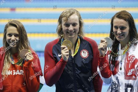 Gold medalist Katie Ledecky (C) of the USA is flanked by SIlver medalist Carlin Jazz of Great Britain (R) and Bronze medalist Boglarka Kapas of Hungary after the Women's 800m Freestyle Final of the Swimming events of the Rio 2016 Olympic Games at the Olympic Aquatics Stadium in Rio de Janeiro, Brazil, 12 August 2016.