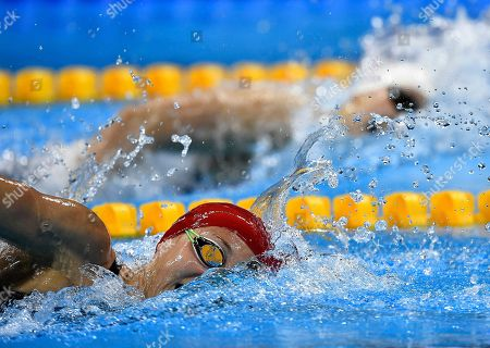 Britain's Jazz Carlin, left, and United States' Katie Ledecky compete during a women's 800-meter freestyle heat during the swimming competitions at the 2016 Summer Olympics, in Rio de Janeiro, Brazil