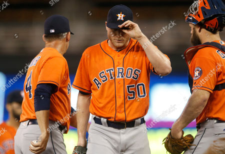 Kevin Chapman Houston Astros pitcher Kevin Chapman, center, leaves during the seventh inning of the second game of a baseball doubleheader against the Minnesota Twins, in Minneapolis. The Astros won 10-2