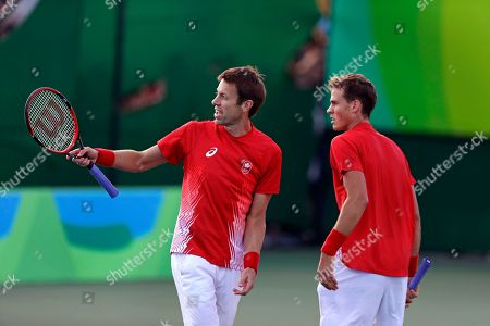 Daniel Nestor, Vasek Pospisil Daniel Nestor, left, and Vasek Pospisil, of Canada, argue a call in their men's doubles match against Rafael Nadal and Marc Lopez, of Spain, at the 2016 Summer Olympics in Rio de Janeiro, Brazil, . Canada lost to Spain in the match