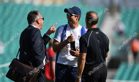 Alec Stewart  (right) presents England's Alastair Cook (Captain)  with a bottle of wine before play as Ian Botham points during day two of the 4th Investec Test Match between England and Pakistan played at The Oval Cricket Ground