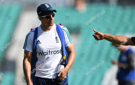 Alec Stewart presents England's Alastair Cook (Captain)  with a bottle of wine during day two of the 4th Investec Test Match between England and Pakistan played at The Oval Cricket Ground