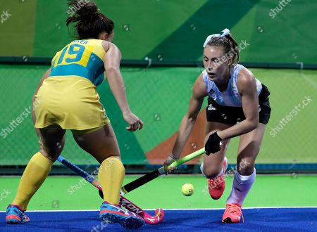 Argentina's Florencia Habif, right, fight for the ball against Australia's Georgie Parker, left, during a women's field hockey match at 2016 Summer Olympics in Rio de Janeiro, Brazil