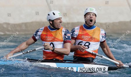 Silver medalists David Florence, left, and Richard Hounslow of Britain react as they finish the canoe single C2 men's final of the canoe slalom at the 2016 Summer Olympics in Rio de Janeiro, Brazil