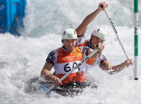 Silver medalists David Florence, left, and Richard Hounslow of Britain compete during the canoe single C2 men's semifinal of the canoe slalom at the 2016 Summer Olympics in Rio de Janeiro, Brazil