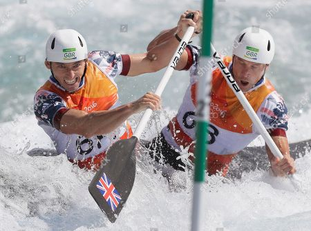 David Florence, left, and Richard Hounslow of Britain compete during the canoe single C2 men's semifinal of the canoe slalom at the 2016 Summer Olympics in Rio de Janeiro, Brazil