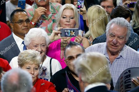 Jackie Siegel Jackie Siegel takes a photo of Republican presidential candidate Donald Trump during a campaign rally, in Kissimmee, Fla