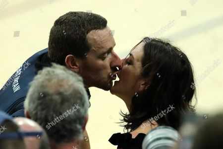 Sir Bradley Wiggins celebrates winning gold and breaking the world record in the Men's Team Pursuit Final by kissing his wife Catherine Wiggins during day seven of the Rio Olympics 2016 on the 12th August 2016