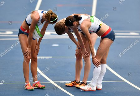Britain's Jessica Andrews, left, Beth Potter, center, and Jo Pavey after the women's 10,000-meter final during the athletics competitions of the 2016 Summer Olympics at the Olympic stadium in Rio de Janeiro, Brazil