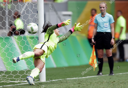 United States goalkeeper Hope Solo fails to stop a penalty during a penalty shoot-out in the quarter-final match of the women's Olympic football tournament between the United States and Sweden in Brasilia . The United States was eliminated by Sweden after a penalty shoot-out