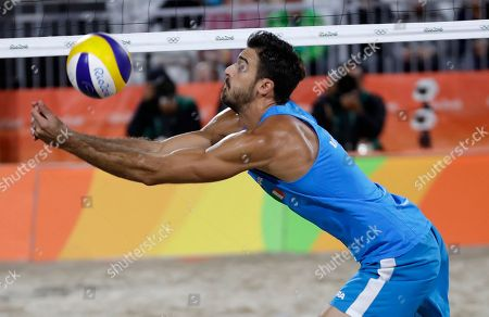 Alex Ranghieri passes a ball during a men's beach volleyball round of 16 match against compatriots Daniele Lupo and Paolo Nicolai