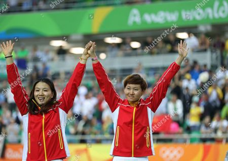 Jinjie Gong, left, and teammate Tianshi Zhong, right, of China pose with their gold medals in the podium of the Women's team sprint finals at the Rio Olympic Velodrome during the 2016 Summer Olympics in Rio de Janeiro, Brazil, Friday, Aug. 12, 2016
