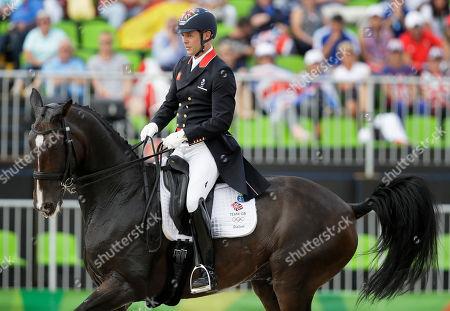 Britain's Spencer Wilton, riding Super Nova II, competes during the team dressage equestrian competition at the 2016 Summer Olympics in Rio de Janeiro, Brazil
