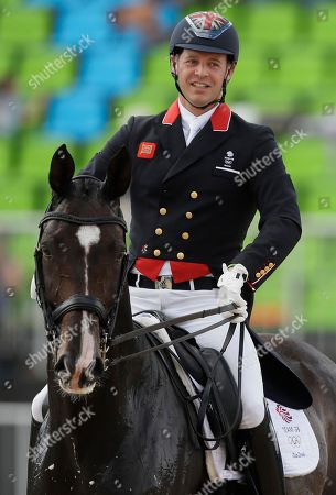 Britain's Spencer Wilton, riding Super Nova II, smiles after they competed during the team dressage equestrian competition at the 2016 Summer Olympics in Rio de Janeiro, Brazil