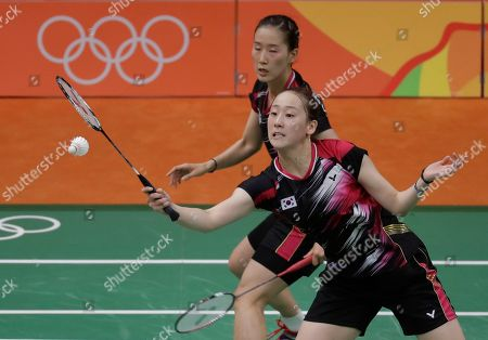 Lee So-hee, Chang Ye-na South Korea's Lee So-hee, front, and Chang Ye-na return a shot to China's Tang Yuanting and Yu Yang during a Women's Double match at the 2016 Summer Olympics in Rio de Janeiro, Brazil