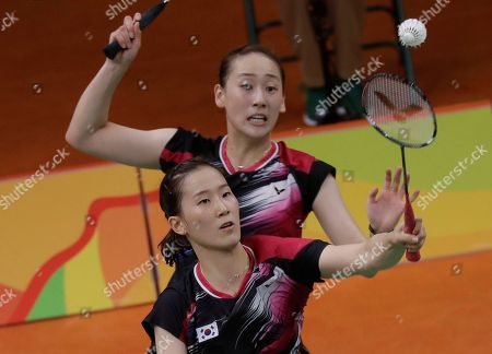 Lee So-hee, Chang Ye-na South Korea's Lee So-hee, back, and Chang Ye-na return a shot to China's Tang Yuanting and Yu Yang during a Women's Double match at the 2016 Summer Olympics in Rio de Janeiro, Brazil