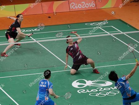 Yu Yang, Tang Yuanting, Lee So-hee, Chang Ye-na China's Tang Yuanting, bottom right, and Yu Yang, bottom left, return a shot to South Korea's Lee So-hee, left, and Chang Ye-na during a Women's Double match at the 2016 Summer Olympics in Rio de Janeiro, Brazil