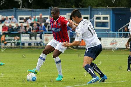 Ashley Palmer of Guiseley and Andre Boucaud of Dagenham during Guiseley vs Dagenham and Redbridge, Vanarama National League Football at Nethermoor Park on 13th August 2016