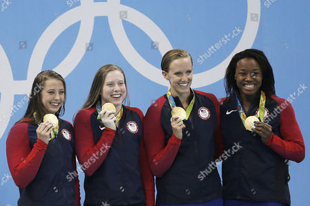 From left to right, United States' Kathleen Baker, Lilly King, Dana Vollmer and Simone Manuel wave to the audience during the medal ceremony for the women's 4 x 100-meter medley relay final during the swimming competitions at the 2016 Summer Olympics, Saturday, Aug. 13, 2016, in Rio de Janeiro, Brazil.
