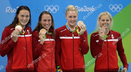 Denmark's Mie Nielsen, Rikke Moller Pedersen, Jeanette Ottesen, and Pernille Blume display their bronze medals for the women's 4 x 100-meter medley relay final during the swimming competitions at the 2016 Summer Olympics, in Rio de Janeiro, Brazil
