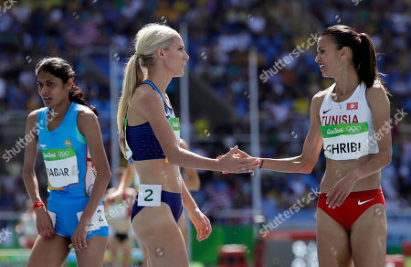 Tunisia's Habiba Ghribi, right, and United States' Emma Coburn compete in a women's 3000-meter steeplechase heat during the athletics competitions of the 2016 Summer Olympics at the Olympic stadium in Rio de Janeiro, Brazil