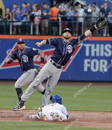 New York Mets' Jose Reyes (7) steals second base safely as the throw to San Diego Padres shortstop Nick Noonan goes wide during the first inning of a baseball game, in New York