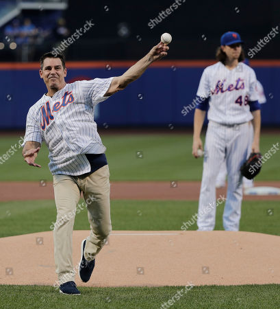 Former Major League Baseball player Billy Bean throws out the first pitch before the start of a baseball game between the New York Mets and the San Diego Padres, in New York. Bean threw out the pitch on the first Mets Pride Night