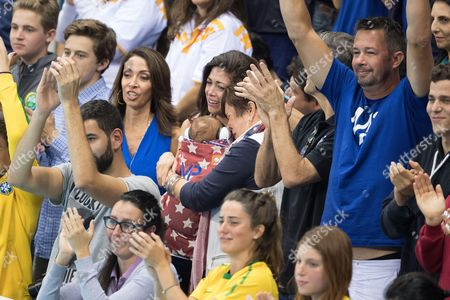 Stock Picture of Nicole Johnson, partner of Michael Phelps pose with their son Boomer and Debbie Phelps - Men's 4 x 100m Medley Relay