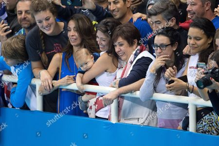 Stock Image of Nicole Johnson, partner of Michael Phelps pose with their son Boomer and Debbie Phelps - Men's 4 x 100m Medley Relay