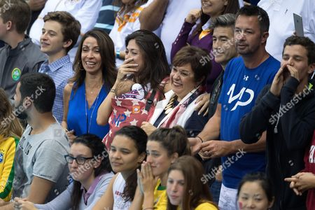 Stock Photo of Nicole Johnson, partner of Michael Phelps pose with their son Boomer and Debbie Phelps - Men's 4 x 100m Medley Relay
