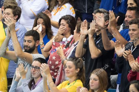 Nicole Johnson, partner of Michael Phelps pose with their son Boomer and Debbie Phelps - Men's 4 x 100m Medley Relay