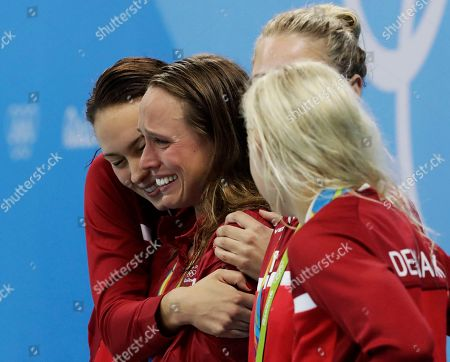 Denmark's Mie Nielsen, Rikke Moller Pedersen, Jeanette Ottesen and Pernille Blume celebrate their bronze medals for the women's 4 x 100-meter medley relay final during the swimming competitions at the 2016 Summer Olympics, in Rio de Janeiro, Brazil
