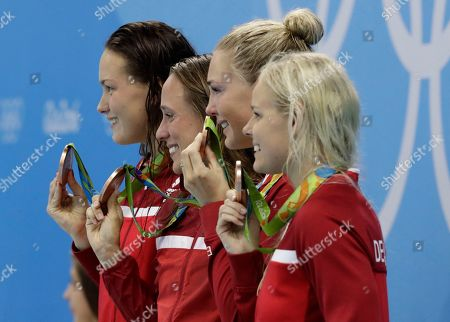 Denmark's Mie Nielsen, Rikke Moller Pedersen, Jeanette Ottesen and Pernille Blume display their bronze medals for the women's 4 x 100-meter medley relay final during the swimming competitions at the 2016 Summer Olympics, in Rio de Janeiro, Brazil