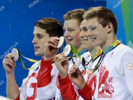 Britain's Chris Walker-Hebborn, Adam Peaty, James Guy and Duncan Scott, left to right, display their silver medals during the medal ceremony for the men's 4 x 100-meter medley relay final during the swimming competitions at the 2016 Summer Olympics, in Rio de Janeiro, Brazil