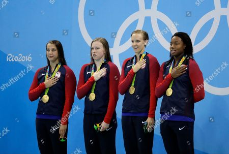 From left to right, United States' Kathleen Baker, Lilly King, Dana Vollmer and Simone Manuel stand for their national anthem during the medal ceremony for the women's 4 x 100-meter medley relay final during the swimming competitions at the 2016 Summer Olympics, in Rio de Janeiro, Brazil