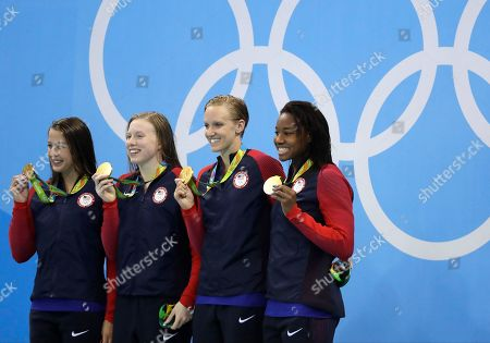 United States' Kathleen Baker, Lilly King, Dana Vollmer and Simone Manuel display their gold medals for the women's 4 x 100-meter medley relay final during the swimming competitions at the 2016 Summer Olympics, in Rio de Janeiro, Brazil