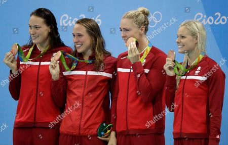 Stock Picture of Denmark's Mie Nielsen, Rikke Moller Pedersen, Jeanette Ottesen, and Pernille Blume display their bronze medals for the women's 4 x 100-meter medley relay final during the swimming competitions at the 2016 Summer Olympics, in Rio de Janeiro, Brazil