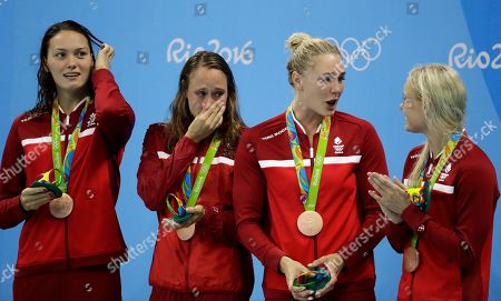 Stock Photo of Denmark's Mie Nielsen, Rikke Moller Pedersen, Jeanette Ottesen, and Pernille Blume display their bronze medals for the women's 4 x 100-meter medley relay final during the swimming competitions at the 2016 Summer Olympics, in Rio de Janeiro, Brazil