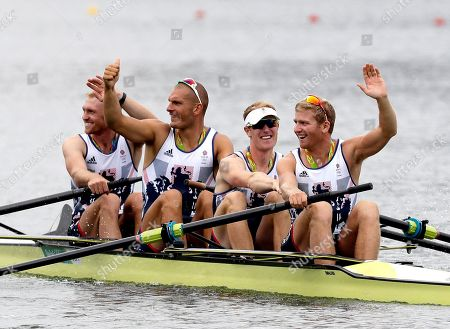 Alex Gregory, Mohamed Sbihi, George Nash and Constantine Louloudis, of Britain, wave after winning gold in the men's rowing four final during the 2016 Summer Olympics in Rio de Janeiro, Brazil