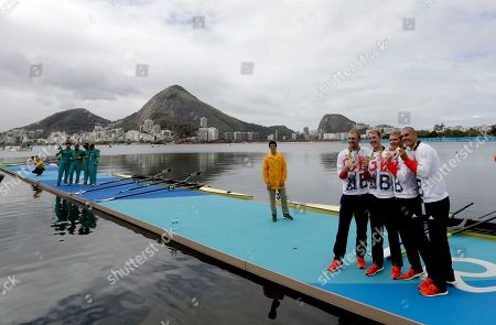 Alex Gregory, Mohamed Sbihi, George Nash and Constantine Louloudis, of Britain, celebrate their gold medal in the men's rowing four final during the 2016 Summer Olympics in Rio de Janeiro, Brazil