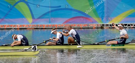 Alex Gregory, Mohamed Sbihi, George Nash and Constantine Louloudis, of Britain, react to winning gold in the men's rowing four final during the 2016 Summer Olympics in Rio de Janeiro, Brazil