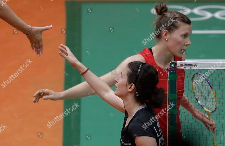 Linda Zetchiri, Sabrina Jaquet Bulgaria's Linda Zetchiri, front, and Switzerland's Sabrina Jaquet shake hands with referee after a Women single match at the 2016 Summer Olympics in Rio deJaneiro, Brazil