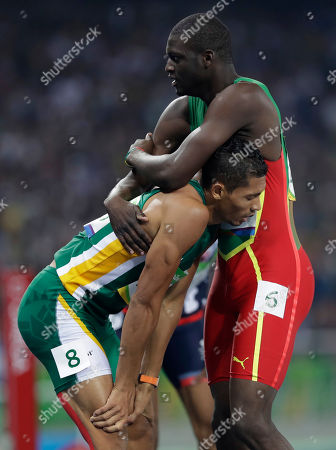 South Africa's Wayde Van Niekerk, left, wins the men's 400-meter final setting a new world record ahead of second placed Grenada's Kirani James, right, during the athletics competitions of the 2016 Summer Olympics at the Olympic stadium in Rio de Janeiro, Brazil