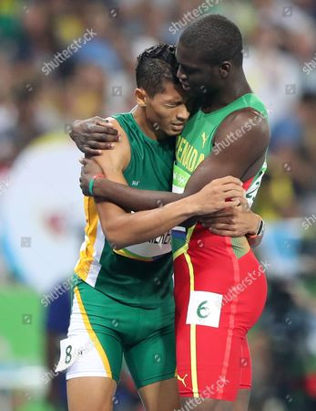 South Africa's Wayde Van Niekerk, left, is embraced by Grenada's Kirani James after winning the men's 400-meter final during the athletics competitions of the 2016 Summer Olympics at the Olympic stadium in Rio de Janeiro, Brazil
