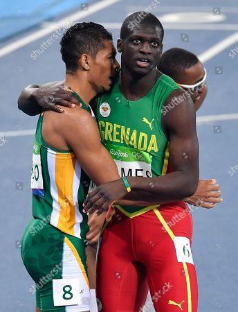 South Africa's Wayde Van Niekerk, center, wins the men's 400-meter final setting a new world record ahead of second placed Grenada's Kirani James during the athletics competitions of the 2016 Summer Olympics at the Olympic stadium in Rio de Janeiro, Brazil