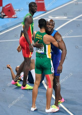 South Africa's Wayde Van Niekerk, center, wins the men's 400-meter final setting a new world record ahead of third placed United States' Lashawn Merritt, right, and second placed Grenada's Kirani James during the athletics competitions of the 2016 Summer Olympics at the Olympic stadium in Rio de Janeiro, Brazil