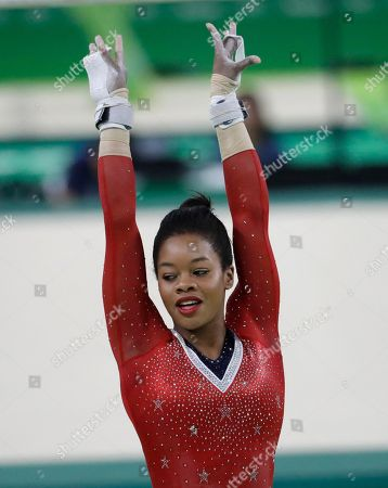 Stock Image of United States' Gabrielle Douglas completes her routine on the uneven bats during the artistic gymnastics women's apparatus final
