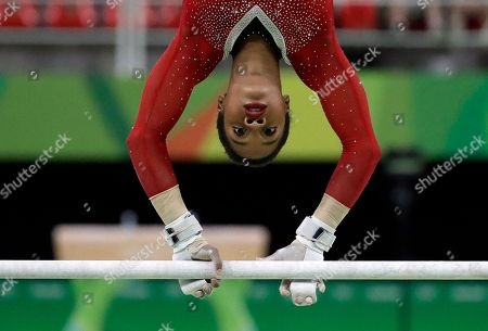 United States' Gabrielle Douglas performs on the uneven bars during the artistic gymnastics women's apparatus final